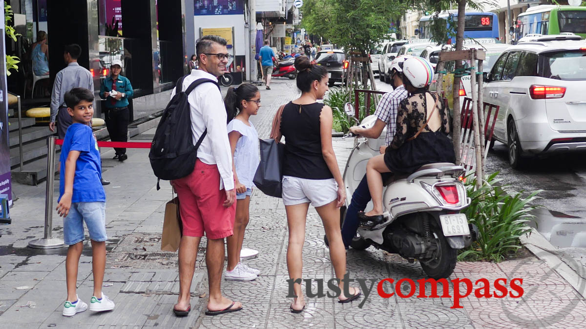 Tourists learning some of Saigon's unusual traffic practices.