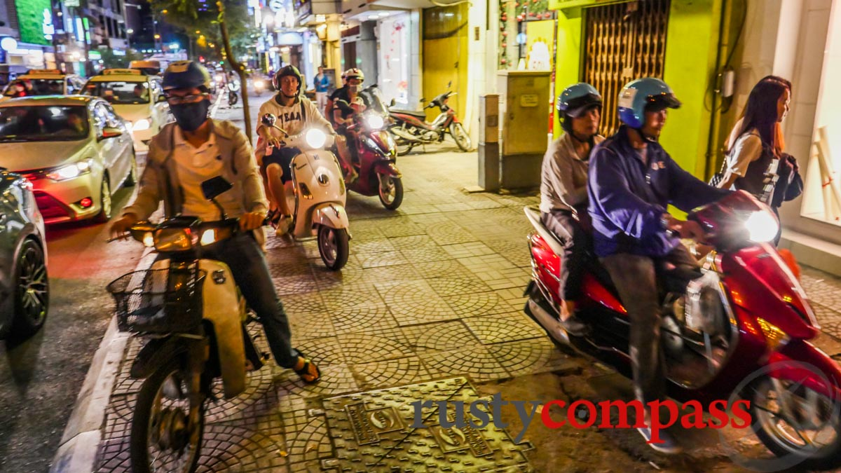 Saigon pavements - motorcycles increase their speeds at night.