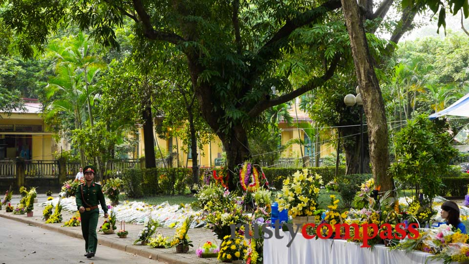 Floral tributes line the path to General Giap's Hanoi villa.
