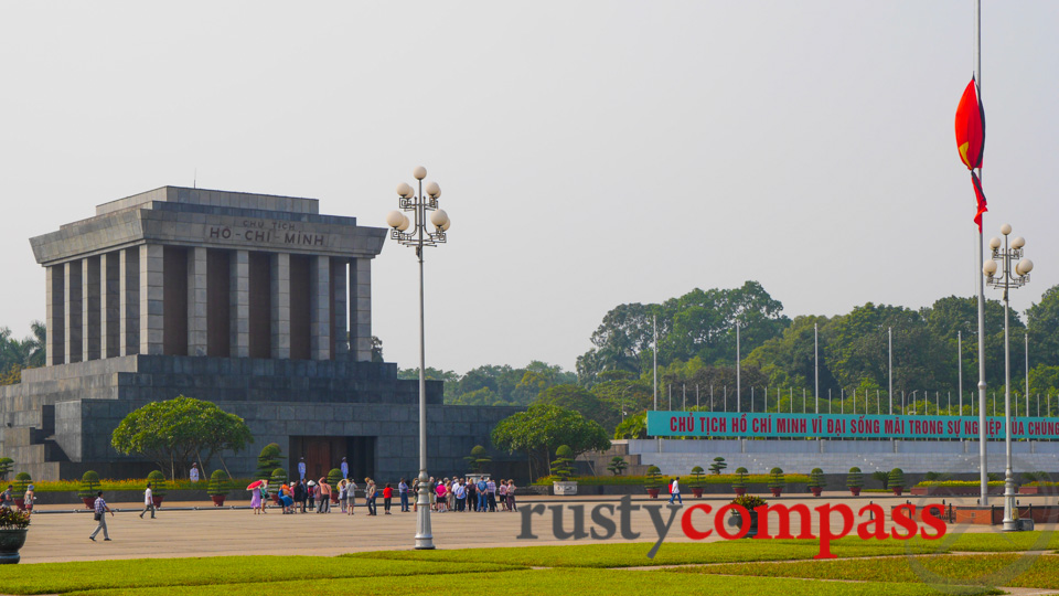 A tied Vietnamese flag at half mast overlooking Ho Chi Minh's Mausoleum.