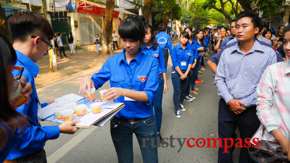 Communist Youth or Thanh Nien, mostly women, distribute water.