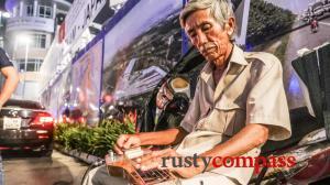 Mournful Hawaiian guitar on Saigon's streets
