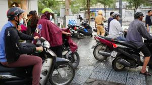 The battle for Saigon's pavements is over - the motorbikes won