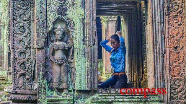 Angkor then and now - a temple attendant.