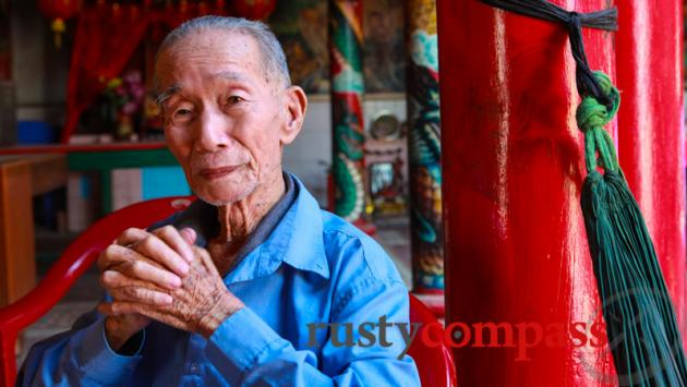Elder in old Chinese temple, downtown Battambang