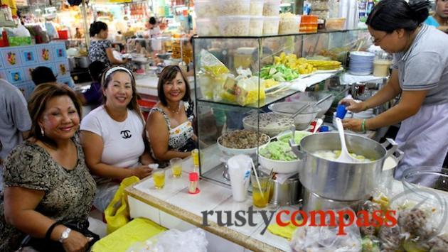 Three American Vietnamese ladies look forward to dessert.