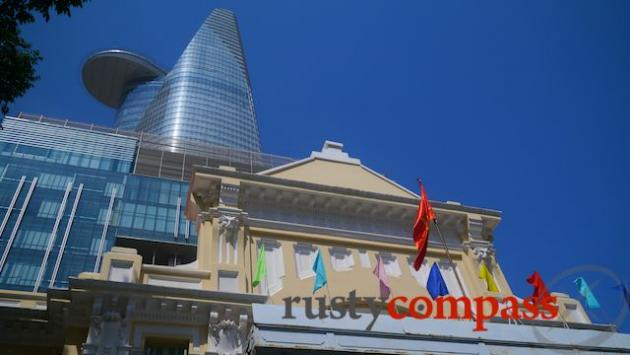 Bitexco Financial Tower springs from the rear of an old French colonial building.