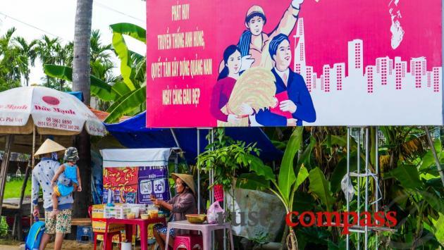 Propaganda poster and a local stall - Cam Kim Island, Hoi An