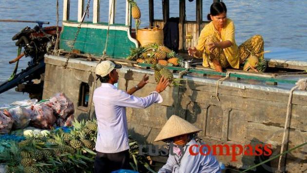 Flying pineapples, Cai Rang floating market.