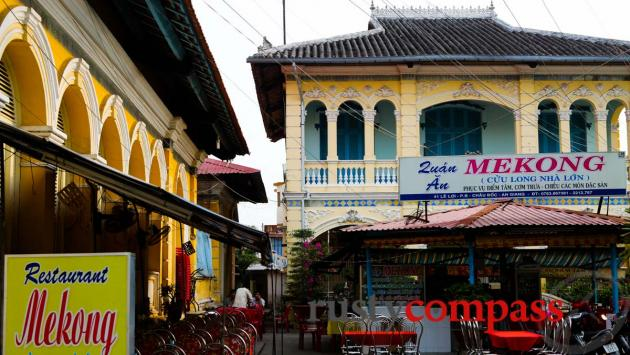 Mekong Restaurant, a traveller favourite in Chau Doc and the family home and Le Cong Bich's ancestral worship house on the left.
