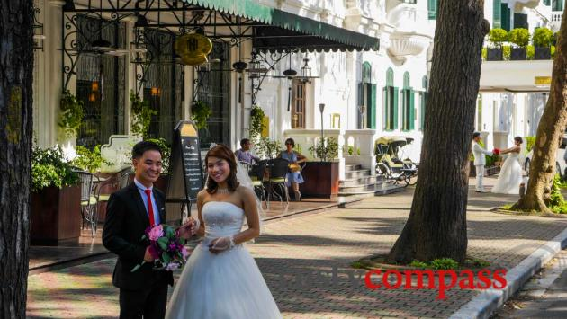 Wedding season outside Hanoi's Metropole Hotel.
