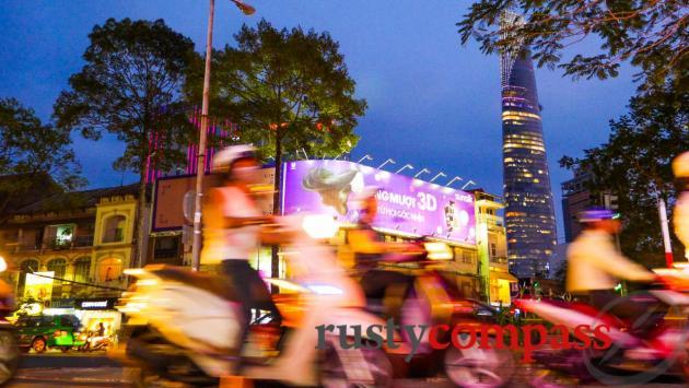 Motorbikes roaring through the city. Saigon