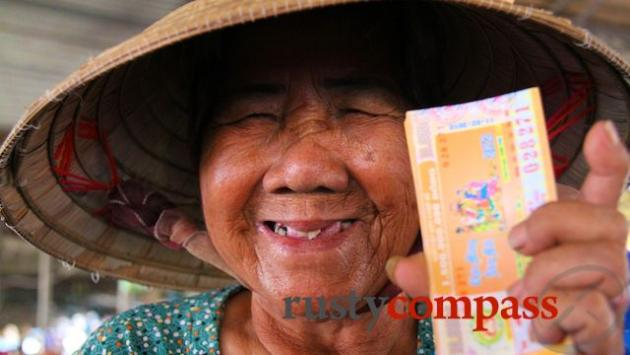Lottery ticket seller, 82, at Ha Tien market