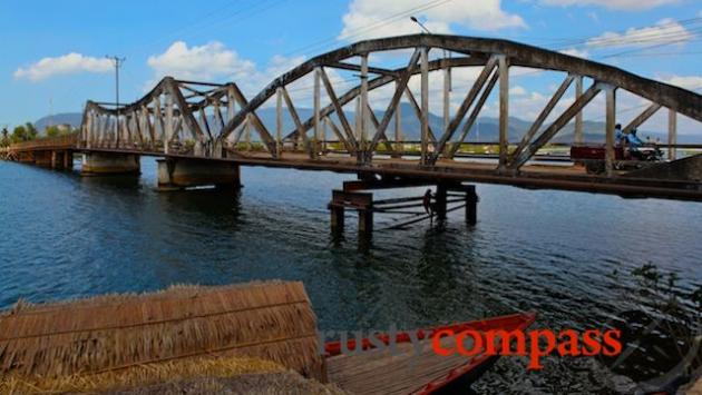 War ravaged French era bridge on the Kampot riverfront