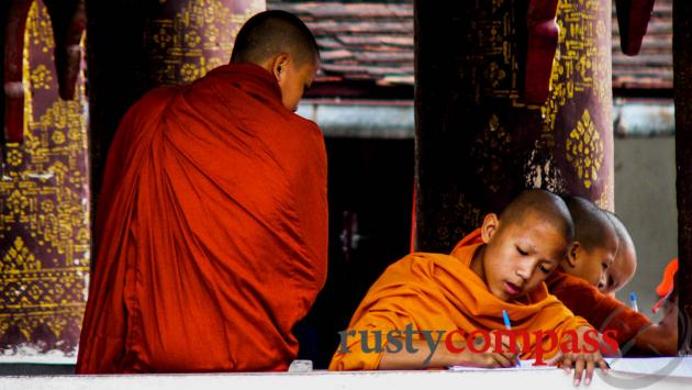Novice monks studying, Luang Prabang