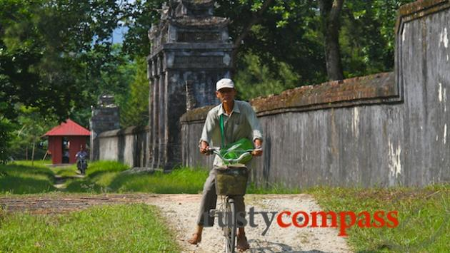 Local rides along the outer wall of Minh Mang's Tomb