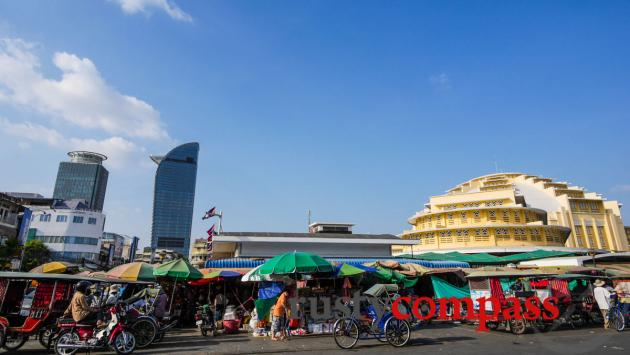 Phnom Penh's central market and an emerging modern skyline.