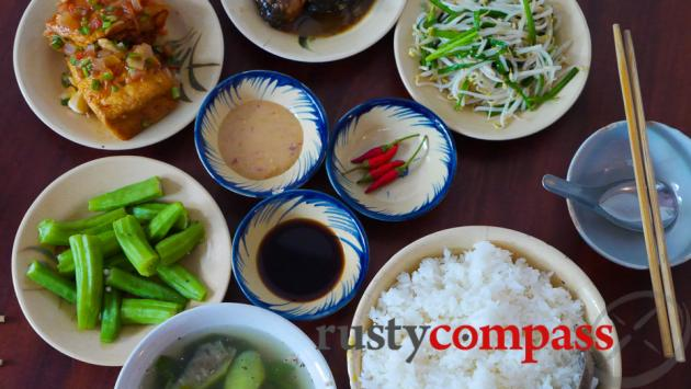 Classic family meal at the original Cuc Gach Quan restaurant.