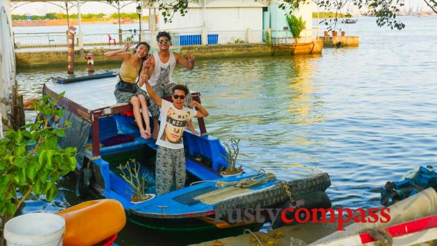 Happy travellers disembark from a boat ride on the river.