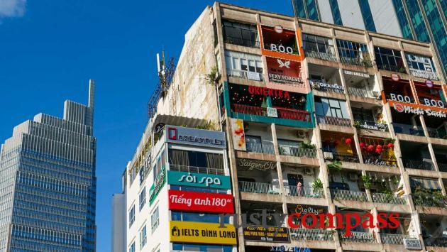 Explore Saigon's unique old apartment buildings and their cafes.