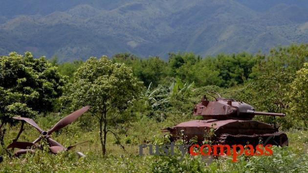 French military junk rusting in a Dien Bien Phu field
