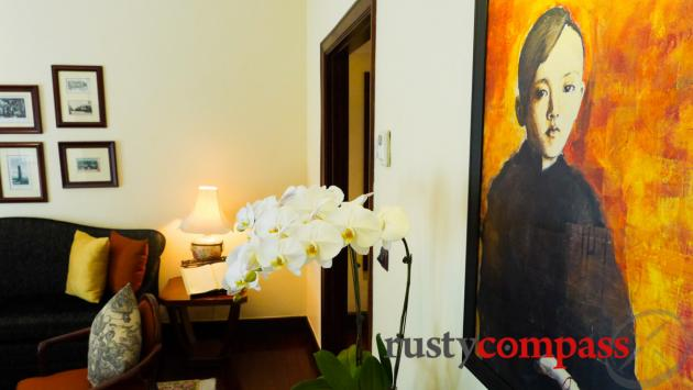 Joan Baez's original painting of a Hmong boy hangs on the wall of this suite room at the Sofitel Metropole Hotel, Hanoi