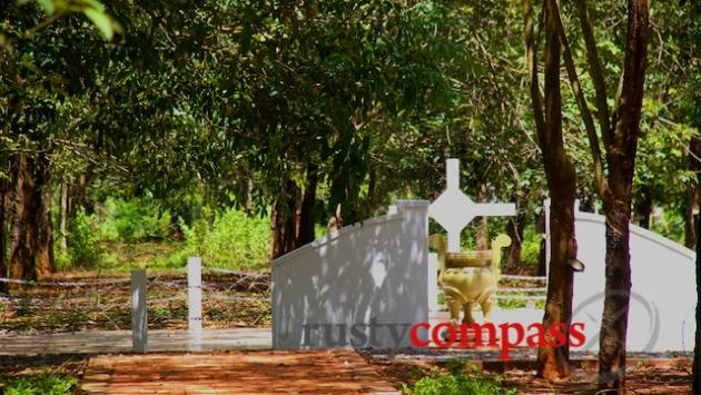 The Long Tan memorial still surrounded by rubber trees.