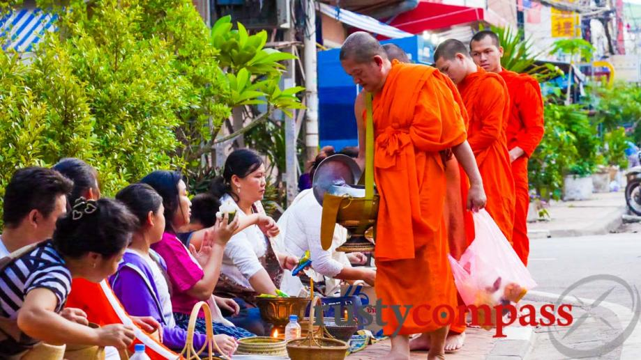 Alms giving in Vientiane