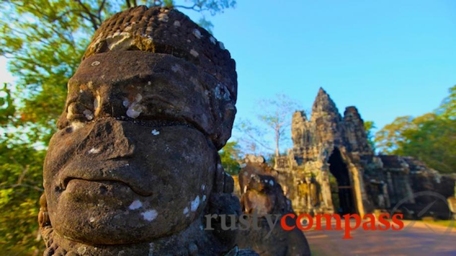 Angkor Thom's late 12th century southern gate. Angkor Thom is...