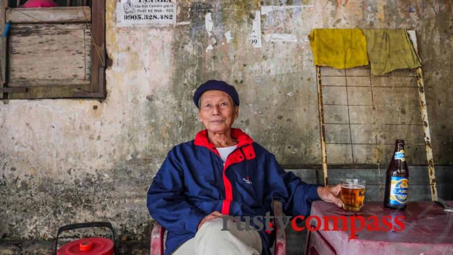 An old veteran in Hoi An. He has two beers...