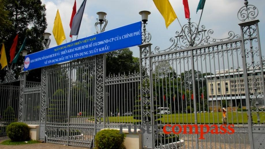 The gates at the Reunification Palace, Saigon. Images of these...