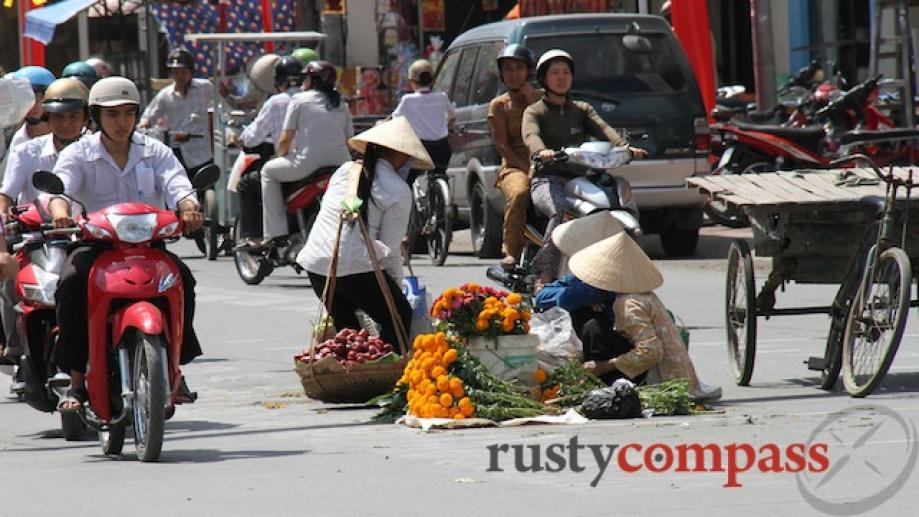 Tra Vinh, Mekong Delta. These flower sellers take their lives...
