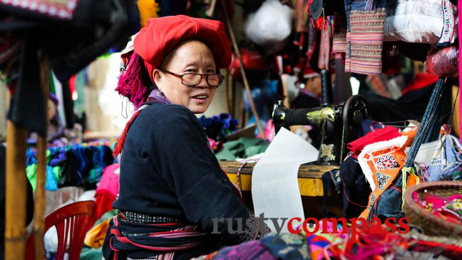 A Red Dzao woman  with beautiful handmade fabrics in...