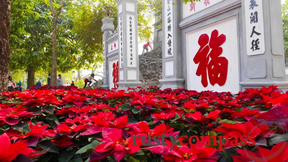 Tet (New Year) flowers at Ngoc Son Temple on Hoan...