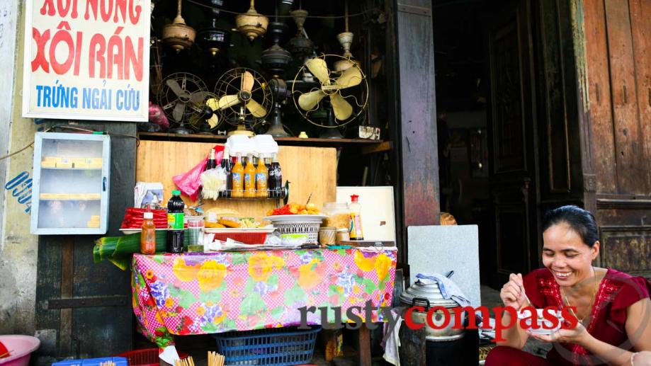 Antique fan repair shop doubles as a sticky rice vendor...