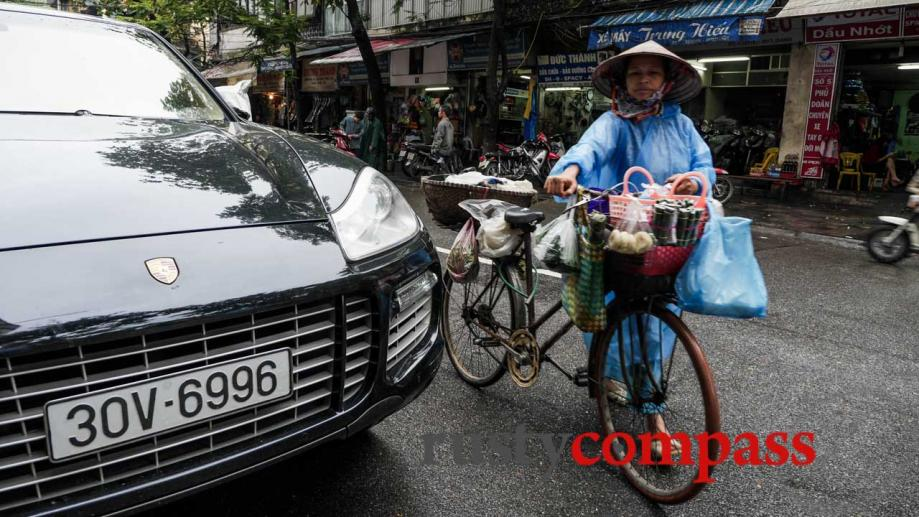 Overtaking a new Porsche, Hanoi. At street level, Hanoi's Old...