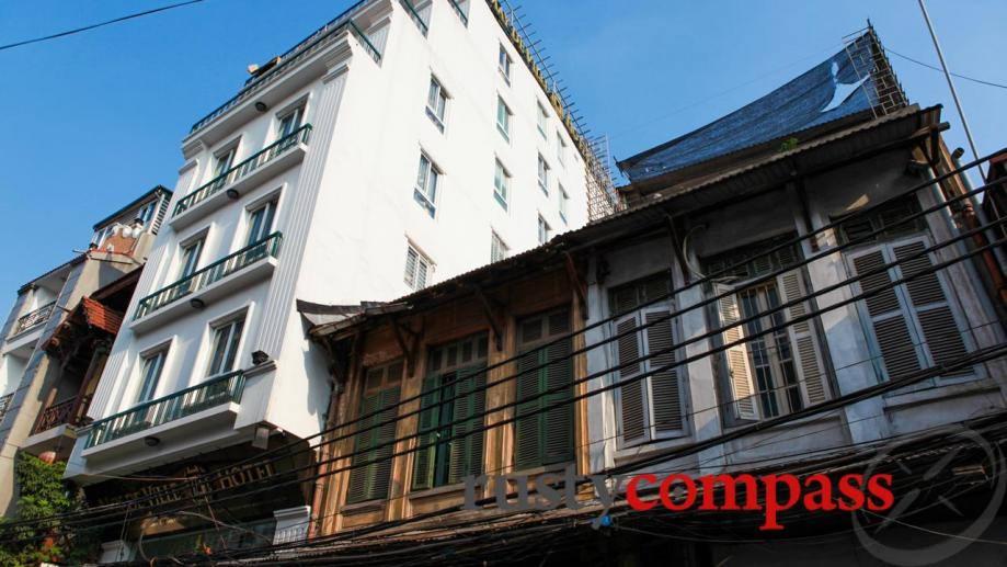 The original buildings of Hanoi's Old Quarter are increasingly being...