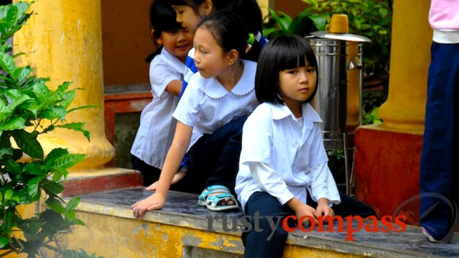 Pensive child at Le Loi School, Hue