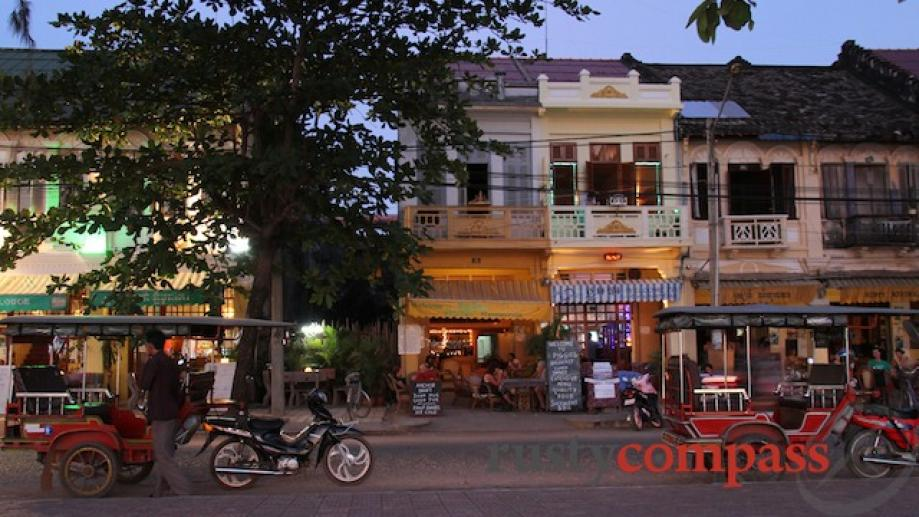 This small strip of bars on the Kampot waterfront comes...