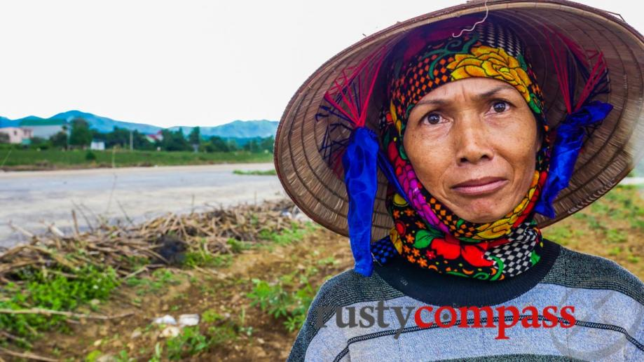 Local minority woman takes a break from planting cassava for...