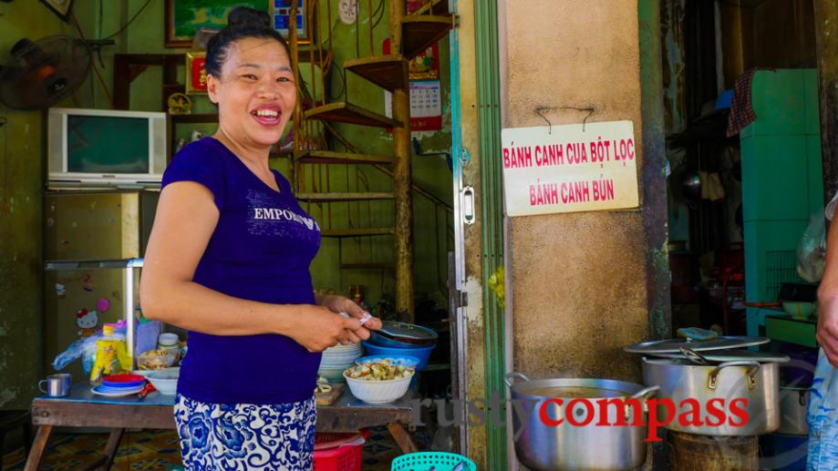 Street stalls sell local specialties like banh canh bun noodles.