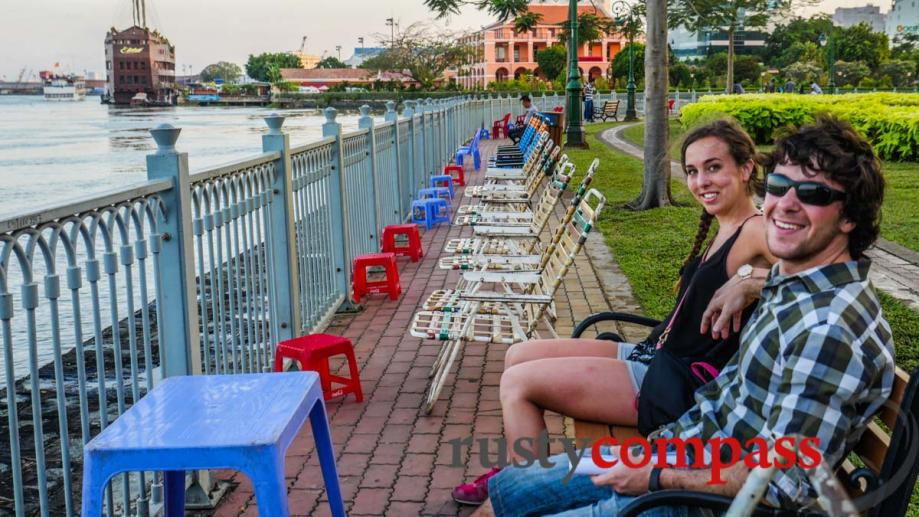 Tourists cooling off by the Saigon River