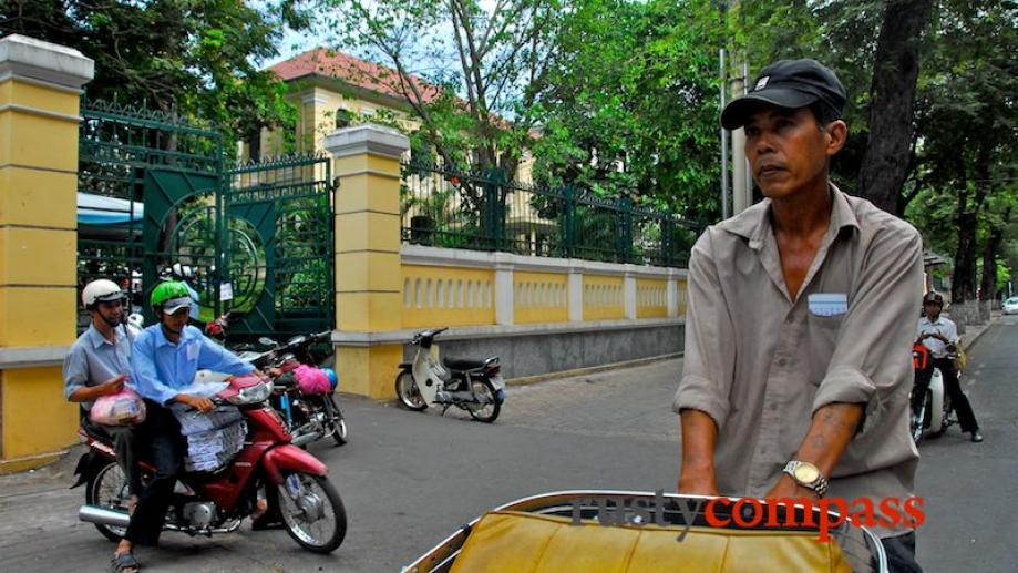 Cyclo passes Saigon's former Education Department building. This block was...