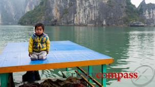 Slice of life Vietnam - Halong Bay fruit boat with little guy on top